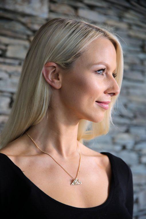 skelligs Irish gold pendant on neck